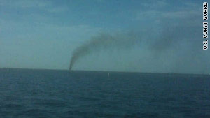 Smoke billows from a wellhead after a towing vessel struck it off the southeastern Louisiana coast Tuesday.