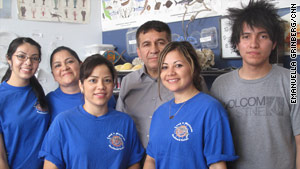 Jairo Tellez (back row, center) runs his seafood distribution business with his wife and kids. He says business is off.