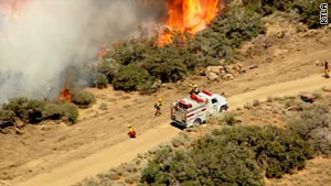 In Los Angeles County, firefighters now have the Crown Fire mostly contained. Good weather has helped.