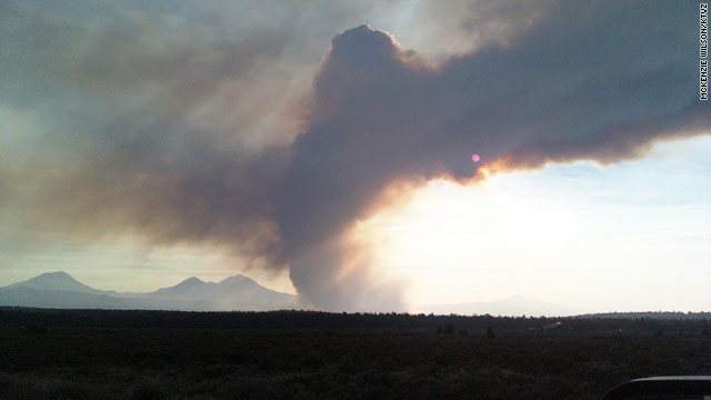 Smoke rises from the Rooster Rock Fire near Bend, Oregon, on Wednesday.