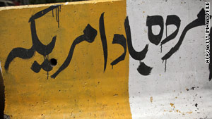 """Death to America"" scrawled on a highway divider in Islamabad. Al Qaeda still recruits heavily in Pakistan."