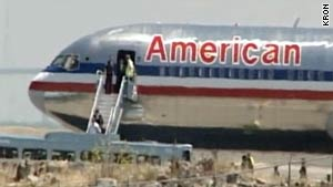 People leave American Airlines Flight 24 and board a bus Thursday afternoon at San Francisco's airport.