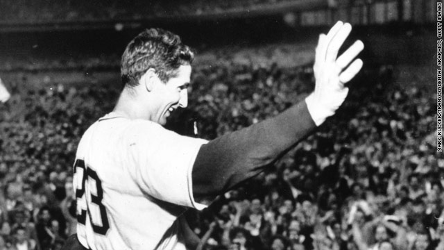 Bobby Thomson waves to the cheering crowd after his game- and pennant-winning home run.