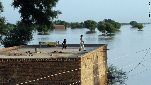 Pakistani children go to the top of a house surrounded by floodwater in Sindh province on Monday.