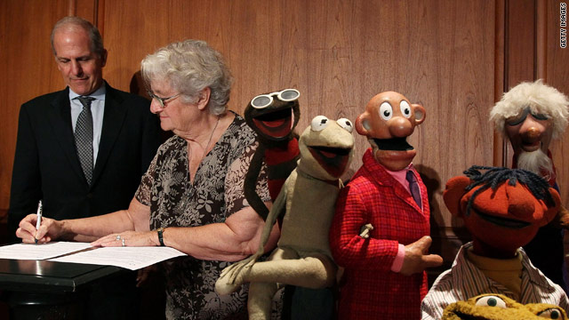 Jane Henson, co-creator of the Muppets, signs some papers at the Smithsonian on Wednesday.