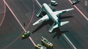 Passengers used the plane's emergency slides to exit the aircraft after the hard landing.