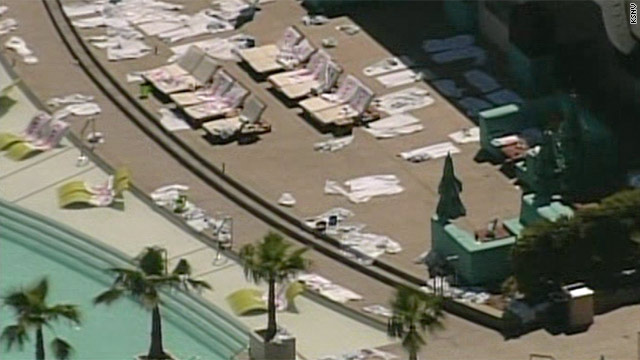 Rumpled towels sit on abandoned lounge chairs after the pool area at the MGM Grand was evacuated Friday.