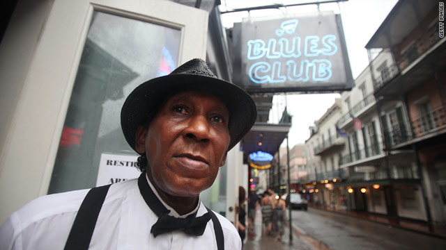Doorman and musician Skip Thompson looks onto Bourbon on Sunday, the five-year anniversary of Hurricane Katrina.