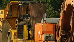 Saturday's fires destroyed an earth mover and damaged other vehicles at the Murfreesboro, Tennessee site.