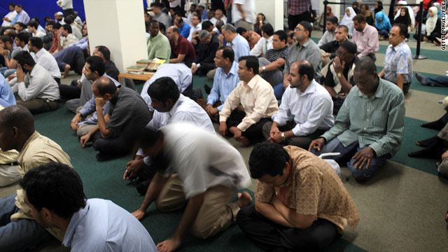 Men attend Friday prayers in a prayer room in the building that is the proposed site of the Park51 mosque and cultural center.