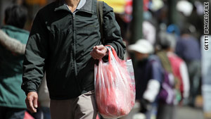A pedestrian carries a plastic grocery bag in San Francisco, California. Assembly Bill 1998 would ban the use of the bags.