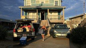Tina McGory of Columbia, South Carolina, and her family clear their rented house Thursday in Kitty Hawk, North Carolina.