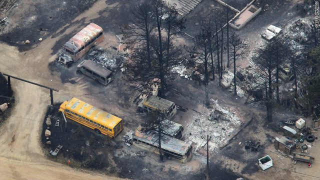 Fire leaves school buses charred Wednesday at Colorado Mountain Ranch summer camp near Boulder, Colorado.