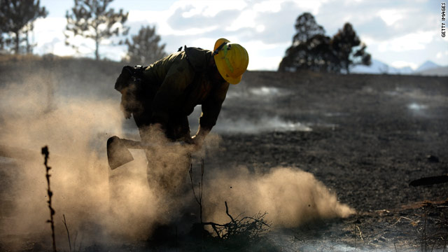 A firefighter puts out hotspots from the Fourmile Canyon Fire in Boulder, Colorado, on Friday.