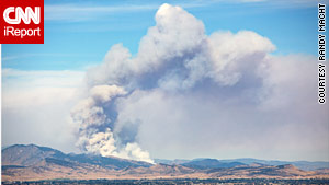 Smoke from the 40-acre brush fire near Loveland, Colorado, could be seen for miles on Sunday.
