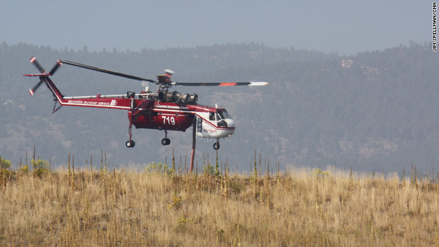 A helicopter makes water drops on hotspots of a wildfire in Loveland, Colorado, on Monday.