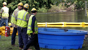 Cleanup crewmembers respond to the Michigan oil spill on July 28.