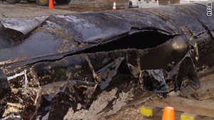 The NTSB released this photo it said showed a 6.5 foot gash in the burst pipeline from the Michigan oil spill.
