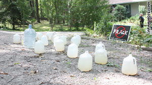 Jugs of water sit in front of a house in Dimock, Pennsylvania, where residents are suing Cabot Oil and Gas Corp.