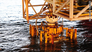 A Coast Guard photo shows the failed blowout preventer being raised from the Macondo well site on September 4.