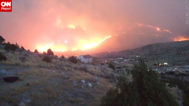 Fire threatens homes in Herriman, Utah, on Sunday night.