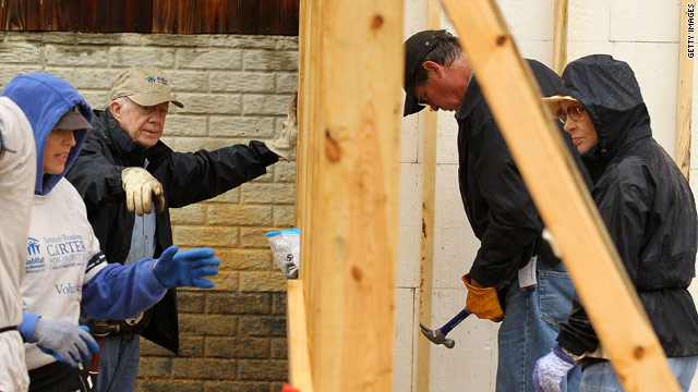 Former President Jimmy Carter, second from left, and his wife Rosalynn, right, help build a house in Washington on Monday.
