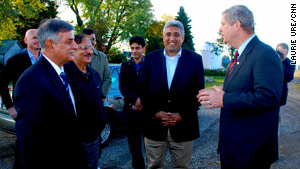 U.S. Agriculture Secretary Tom Vilsack (right) chats Friday with Mohammad Asef Rahimi (center) from Afghanistan and Nazar Muhammad Gondal (left) of Pakistan.