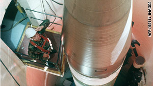 An Air Force technician inspects a Minuteman III missile in a silo in North Dakota.