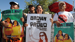 Demonstrators protest in Phoenix, Arizona, in May against the state's tough immigration law.