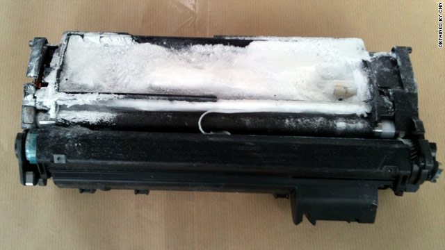 A suspicious package contained a &quot;manipulated&quot; toner cartridge that had white powder on it, a law enforcement source said.