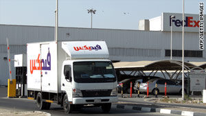 A truck leaves the FedEx terminal in at the Dubai airport on Saturday.