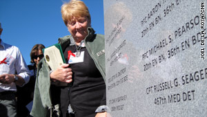 Christine Gaffaney, widow of Cpt. John Gaffaney, looks at a memorial stone in Fort Hood, Texas, on Friday.