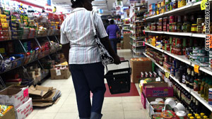 A woman in Brooklyn, New York, shops at a dollar store in September. A report examines hunger in U.S. households.