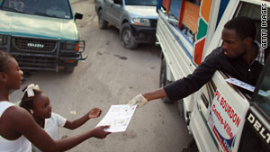 A Haitian Ministry of Health worker hands out an informational pamphlet about cholera in Port-au-Prince.