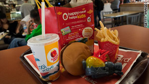 The ordinance requires Happy Meals and other fast food with toys to meet new nutritional standards .