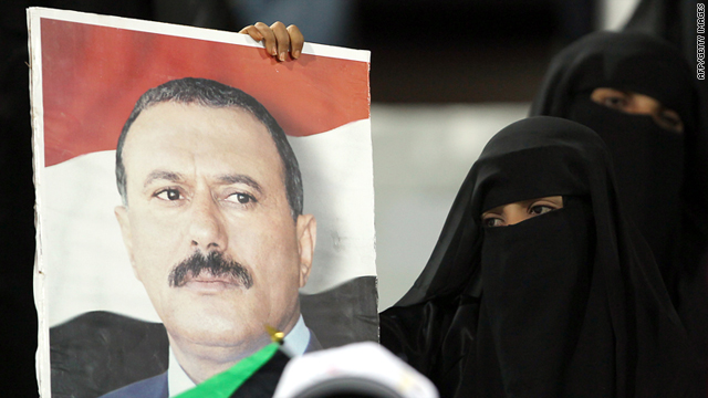 A fan holds a picture of Yemen President Ali Abdullah Saleh during the 20th Gulf Cup in Abyan on Sunday.