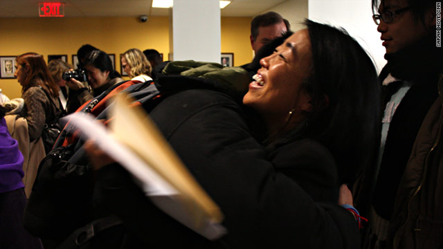 Helen Gym, a board member for Asian Americans United, hugs a student after Wednesday's announcement.