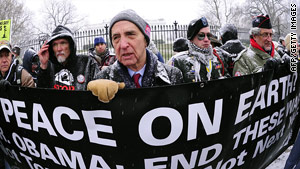 "Daniel Ellsberg, center, former military analyst who released the ""Pentagon Papers"" joins the anti-war protest."