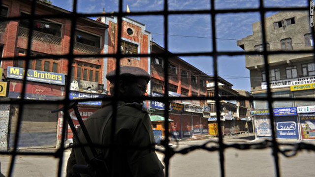 An Indian paramilitary trooper stands guard on a street under curfew in Srinagar, the capital of Kashmir, on September 24.