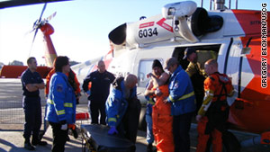 Coast Guard rescuers transfer a member of the Sandy M crew  at Air Station Sitka, Alaska, on Saturday.