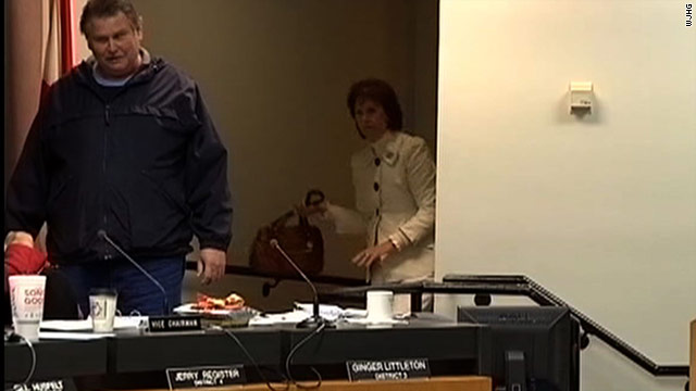 Ginger Littleton used her purse in a failed attempt to subdue a gunman at a Floridal school board meeting.