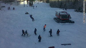 Skiers are helped off a lift at Maine's Sugarloaf Mountain Ski Resort on Tuesday.