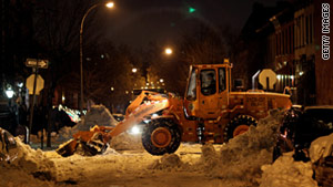Sanitation workers clear snow at a Brooklyn intersection on Wednesday, December 29.