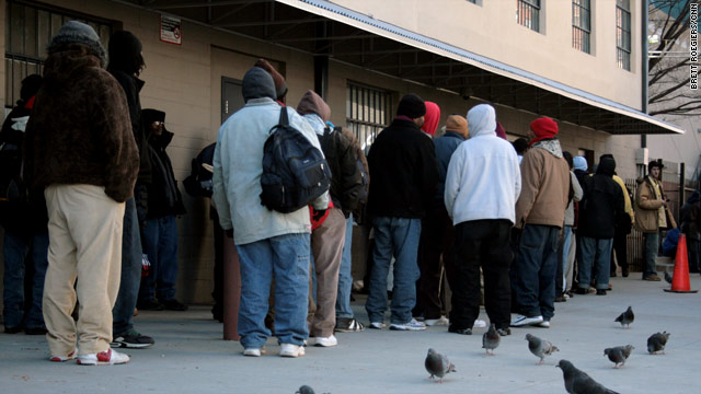 Homeless people line up outside a shelter in Atlanta, Georgia, as unusually cold weather came in this week.