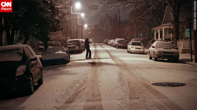 A light dusting of snow covers the streets in Atlanta's Grant Park neighborhood Thursday evening.