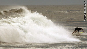 Hurricane Bill creates strong waves off a New York beach in August. Last year's hurricane season was below average.