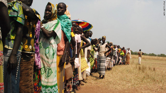 Southern Sudanese wait for rations of food airdropped from the United Nations World Food Programme in early November.