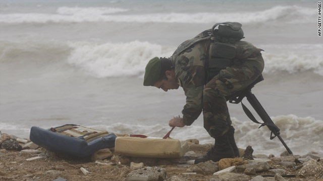 A soldier inspects debris washed up after an airliner crashed off the Lebanese coast.