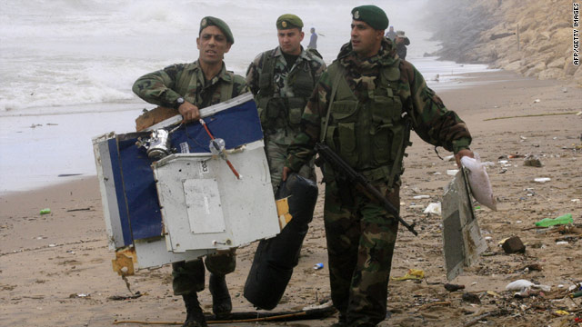 Lebanese troops carry the debris of an Ethiopian Boeing 737 that crashed into the Meditteranean.