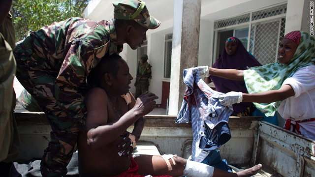 Soldiers attend to the wounded from a rebel attack in Mogadishu last week.